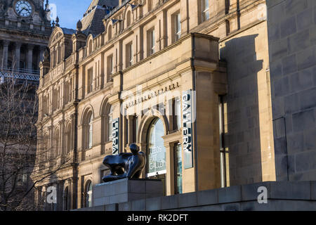 Leeds Art Gallery on The Headrow. A Henry Moore sculpture, Reclining Woman: Elbow, stands outside the entrance of the council-owned gallery - Stock Photo