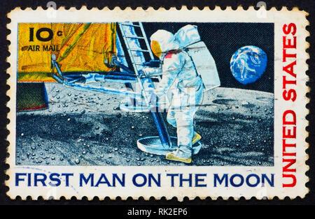 UNITED STATES OF AMERICA - CIRCA 1969: a stamp printed in the United States of America shows Man's 1st landing on the moon, Apollo 11, circa 1969 - Stock Photo