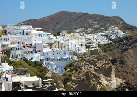 Santorini spectacular view of villages of white houses on the rocks, Cyclades Islands, Greece - Stock Photo