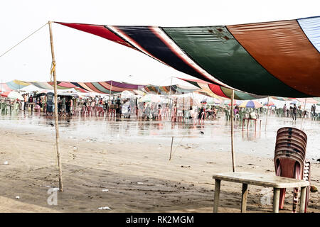 Versova beach, Mumbai India 10, Jan 2019: Beach market View of crowded with tourists and vendors in during new year festival, causes water pollution d - Stock Photo