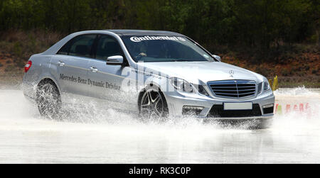 Johannesburg, South Africa, 25 November - 2013: Advanced driver training with sports car skidding on skid pan. - Stock Photo