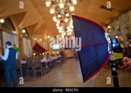 Soft-box Diffuser f S-Light S-Lite Flash . Professional 40cm Rigid Quick Folding Softbox for Speedlight Speedlite Flash . Blue backgrounds - Stock Photo