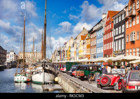 23 September 2018: Copenhagen, Denmark - Classic cars on display beside the canal in the Copenhagen district of Nyhavn, with its colourful 17th and 18 - Stock Photo
