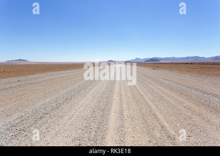 Typical gravel road in Namibia - Stock Photo