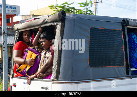Workers in the back of a van in Chennai, Southern India - Stock Photo