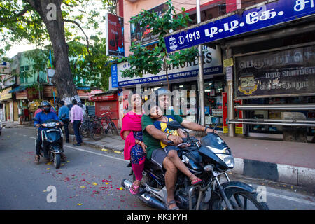 A family on their on their motorbike in Chennai, Southern India - Stock Photo