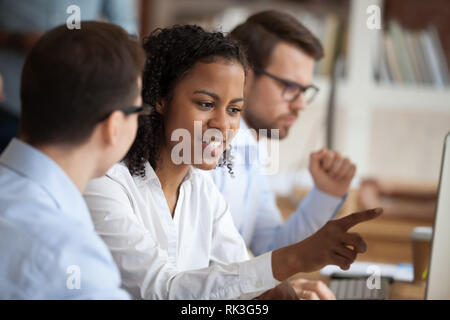 African young intern or mixed-race new employee talking to mentor - Stock Photo