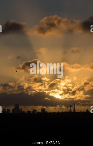 London, UK. 9th Feb 2019. UK Weather: View of the London Skyline from Wembley Park Sun rising behind the Shard and BT Tower. Credit: amanda rose/Alamy Live News - Stock Photo