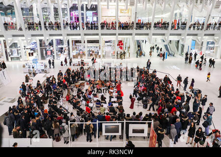 New York, USA. 8th Feb, 2019. Musicians perform during a symphony concert for Chinese New Year at the Oculus of the World Trade Center in New York City, the United States, Feb. 8, 2019. The Oculus of the World Trade Center, a new landmark in New York City, presented a dynamic symphony concert on Friday night in its atrium to celebrate the Chinese New Year. Credit: Wang Ying/Xinhua/Alamy Live News - Stock Photo