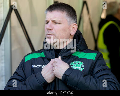 Easter Road, Edinburgh, UK. 9th Feb, 2019. Scottish Cup football fifth round, Hibernian versus Raith Rovers; Eddie May caretaker Hibernian Manager feeling the cold before kick off Credit: Action Plus Sports/Alamy Live News - Stock Photo