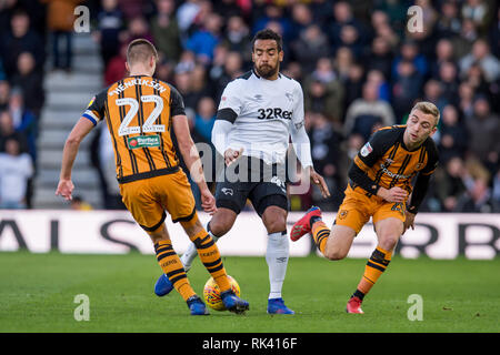 Derby, UK. 09th Feb, 2019. Markus Henriksen of Hull City beats Tom Huddlestone of Derby County to the ball during the EFL Sky Bet Championship match between Derby County and Hull City at the Pride Park Stadium, Derby, England on 9 February 2019. Photo by Matthew Buchan. Editorial use only, license required for commercial use. No use in betting, games or a single club/league/player publications. Credit: UK Sports Pics Ltd/Alamy Live News - Stock Photo