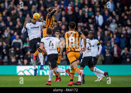 Derby, UK. 09th Feb, 2019. Tom Huddlestone of Derby County wins the ariel battle with Jackson Irvine of Hull City during the EFL Sky Bet Championship match between Derby County and Hull City at the Pride Park Stadium, Derby, England on 9 February 2019. Photo by Matthew Buchan. Editorial use only, license required for commercial use. No use in betting, games or a single club/league/player publications. Credit: UK Sports Pics Ltd/Alamy Live News - Stock Photo