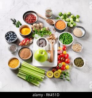 Vegetables, fruit, grain, superfoods for vegan and vegetarian eating. Clean eating. Detox, dieting food concept - Stock Photo