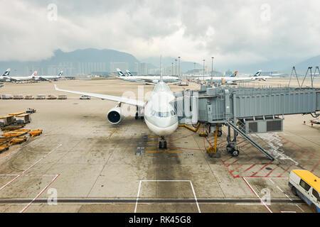 HONG KONG - MARCH 08, 2016: view from Hong Kong International Airport terminal. Hong Kong International Airport is the main airport in Hong Kong - Stock Photo