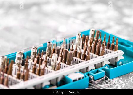 Screwdriver attachments close-up. Power tool. A set of nozzles on the screwdriver - Stock Photo