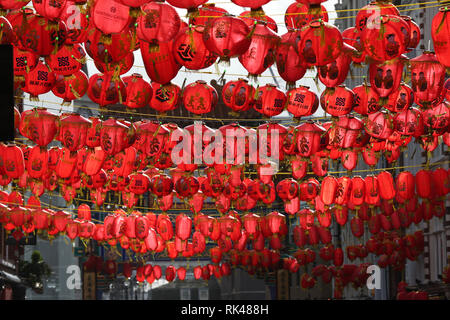 Lanterns over Wardour Street during a pre-Chinese New Year celebration in Chinatown, London, ahead of this weekend's main Chinese New Year celebrations on Sunday which marks the Year of the Pig. - Stock Photo
