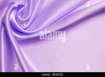 Lilac silk background with drapery in a corner - Stock Photo