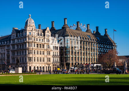 London, England / United Kingdom - 2019/01/28: House of Commons Community Nursery and the tube Westminster Station building at the Parliament Square i - Stock Photo