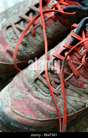 dirty cross country running shoes - Stock Photo