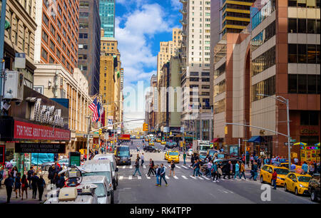 New York, NY / USA - 04.13.2018: 7th Avenue in Manhattan with crosswalk people and traffic - Stock Photo
