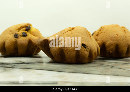 Healthy vegan banana blueberry muffins with fresh berries overhead shot . - Stock Photo
