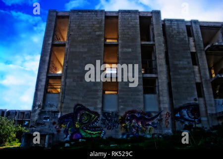 Old and abandoned buildings in ruins located in Pembroke, Malta. - Stock Photo