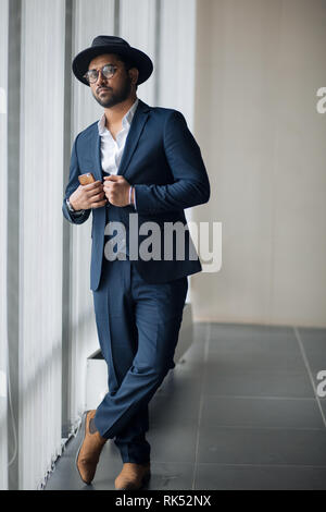 awesome african guy in trendy suit posing to the camera. Hindoo mafia.dude - Stock Photo