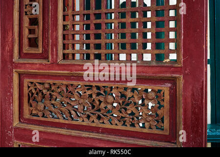 Doorway with decorative carving on a old shophouse building on the street in George Town, Penang, Malaysia - Stock Photo