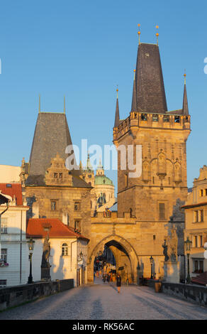 Prague - The gothic west tower of Charles bridge and St. Nicholas church in the morning. - Stock Photo