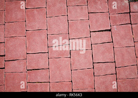 Red pavement background. Pavement texture. Perspective View of Monotone Gray Brick Stone on The Ground for Street Road. Sidewalk, Driveway, Pavers - Stock Photo