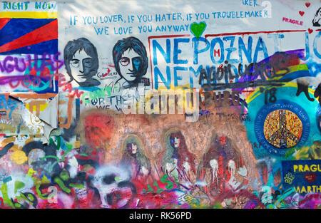 PRAGUE, CZECH REPUBLIC - OCTOBER 12, 2018:  Detail of John Lennon Peace Wall created in 1980. - Stock Photo