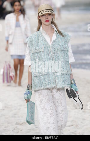 PARIS, FRANCE - OCTOBER 02: A model walks the runway during the Chanel show as part of the Paris Fashion Week Womenswear Spring/Summer 2019 on October - Stock Photo