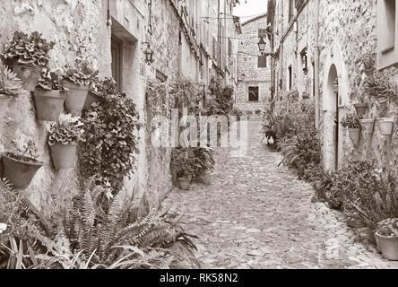 Mallorca - The old aisles of Valldemossa village. - Stock Photo