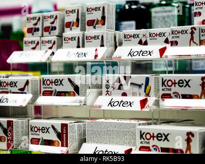 Kotex on shelf in supermarket. Kotex is a brand of feminine hygiene products, which includes the Kotex maxi, thin and ultra thin pads. - Stock Photo