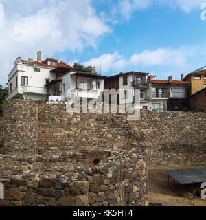 Sozopol, Bulgaria - September 03, 2014: Remains of stone fortress wall and houses. View of the old town Sozopol in Bulgaria. - Stock Photo
