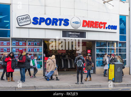 Sports Direct shop front entrance in Brighton, East Sussex, England, UK. Retail store. - Stock Photo