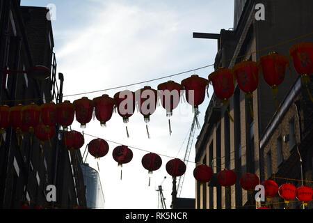 China Town lanterns across urban buildings in Soho, London, England - Stock Photo