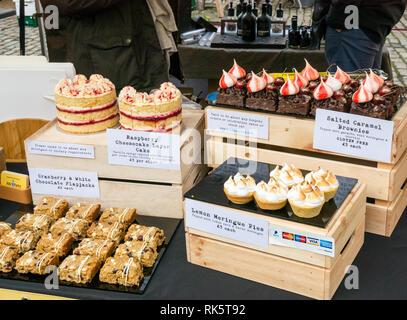 Artisan cake stall, Abbi's Pantry. Lemon meringue pies, salted caramel brownies, cheesecake & flapjacks, Leith market, Edinburgh, Scotland, UK - Stock Photo