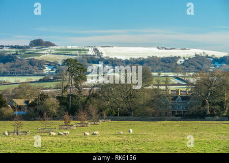 Snow covered Brailes Hill, Warwickshire, England in winter on a bright sunny day - Stock Photo