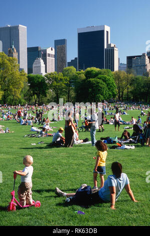 People enjoying the Sheep Meadow In Central Park during spring, New York City, USA - Stock Photo