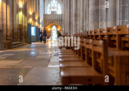 Interior of Winchester Cathedral, Hampshire, England. View of nave with chairs in foreground - Stock Photo