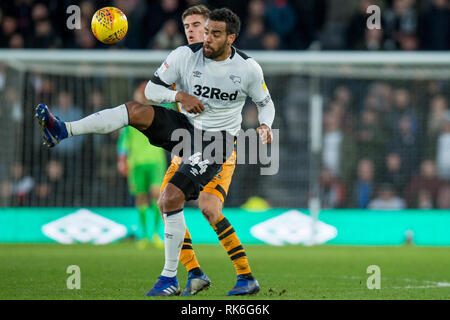 Derby, UK. 9th Feb 2019. Tom Huddlestone of Derby County battles with Markus Henriksen of Hull City during the EFL Sky Bet Championship match between Derby County and Hull City at the Pride Park Stadium, Derby, England on 9 February 2019. Photo by Matthew Buchan.  Editorial use only, license required for commercial use. No use in betting, games or a single club/league/player publications. Credit: UK Sports Pics Ltd/Alamy Live News - Stock Photo