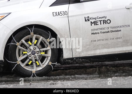 Bellevue, WA, USA. 9th Feb, 2019. Bellevue is snowed in. King County metro department of transportation vehicle with snow chains - Stock Photo