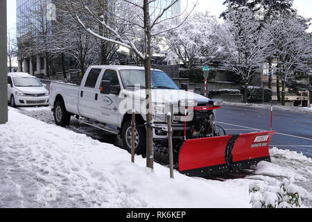 Bellevue, WA, USA. 9th Feb, 2019. Bellevue is snowed in. Snowplows are on the roads - Stock Photo