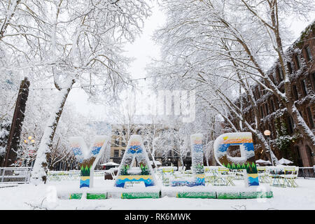 Washington, USA. 9th Feb 2019. Occidental Square is deserted as a strong winter storm blankets Seattle in six inches of snow. Credit: Paul Christian Gordon/Alamy Live News - Stock Photo