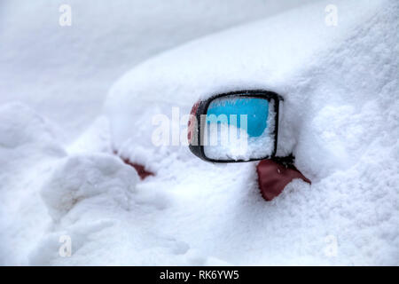 Car rearview mirror under the snow. - Stock Photo