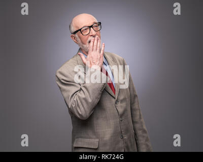Portrait of senior caucasian yawning man . He is exhausted and tired - Stock Photo