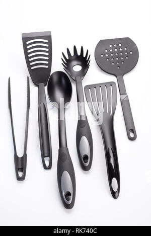 Cutlery abs pallet kitchen ladles and pliers on a white background - Stock Photo