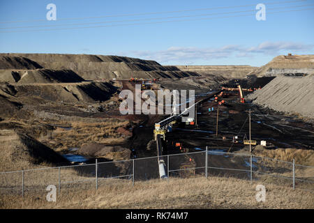 Activity inside an open pit coal mine, machinery and operations to extracting coal from the earth, in the Powder River Basin in Wyoming, USA. - Stock Photo
