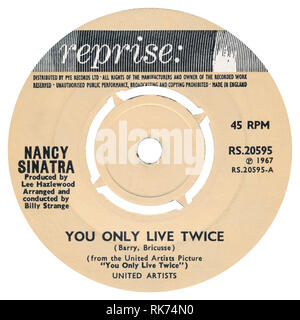 UK 45 rpm single of You Only Live Twice by Nancy Sinatra on the Reprise label from 1967. Written by John Barry and Leslie Bricusse, arranged by Billy Strange and produced by Lee Hazlewood. - Stock Photo